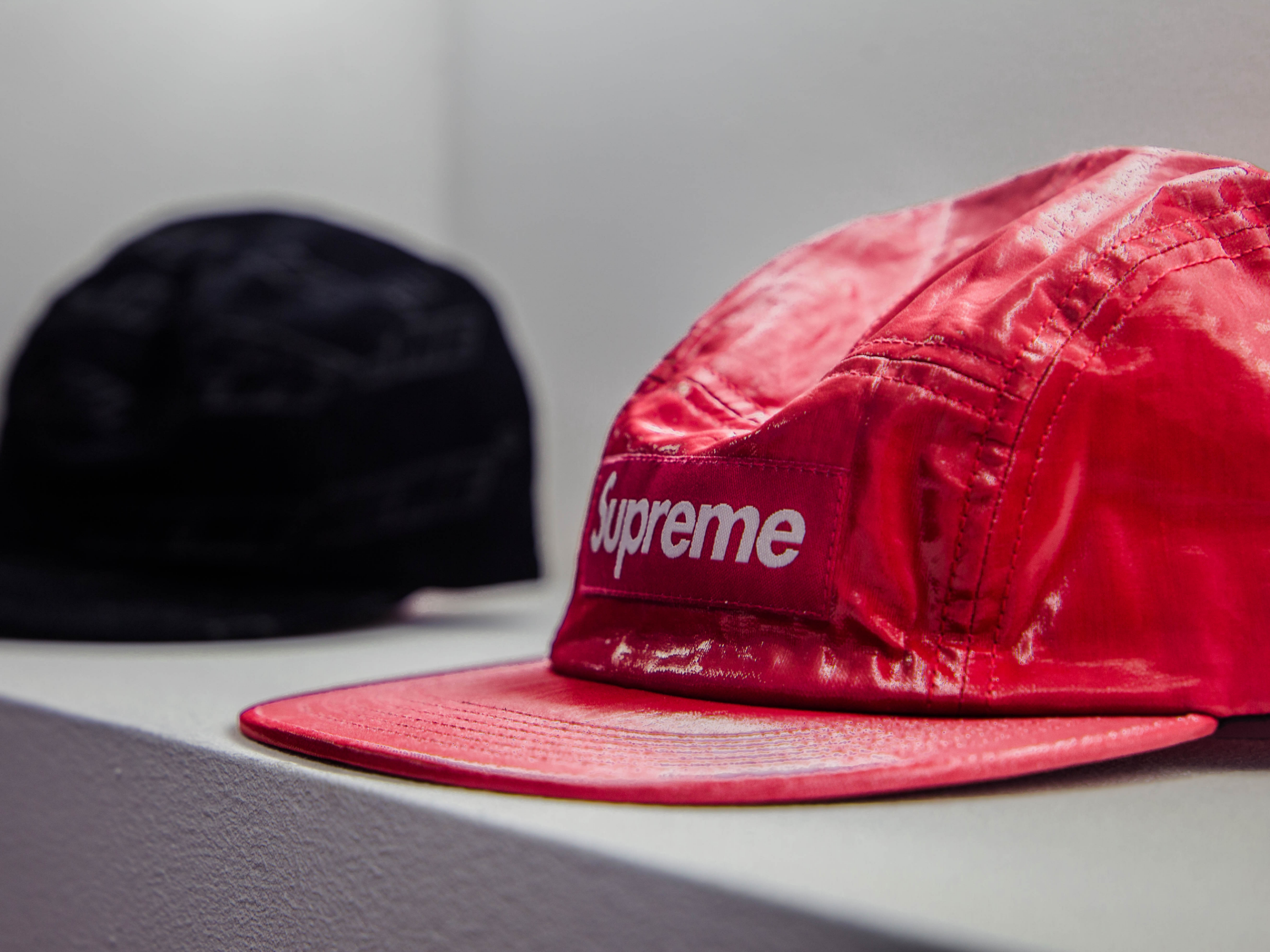 Black and red hat on table.