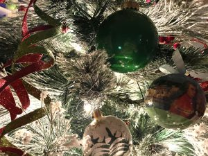 close up of Christmas tree with ornaments and lights