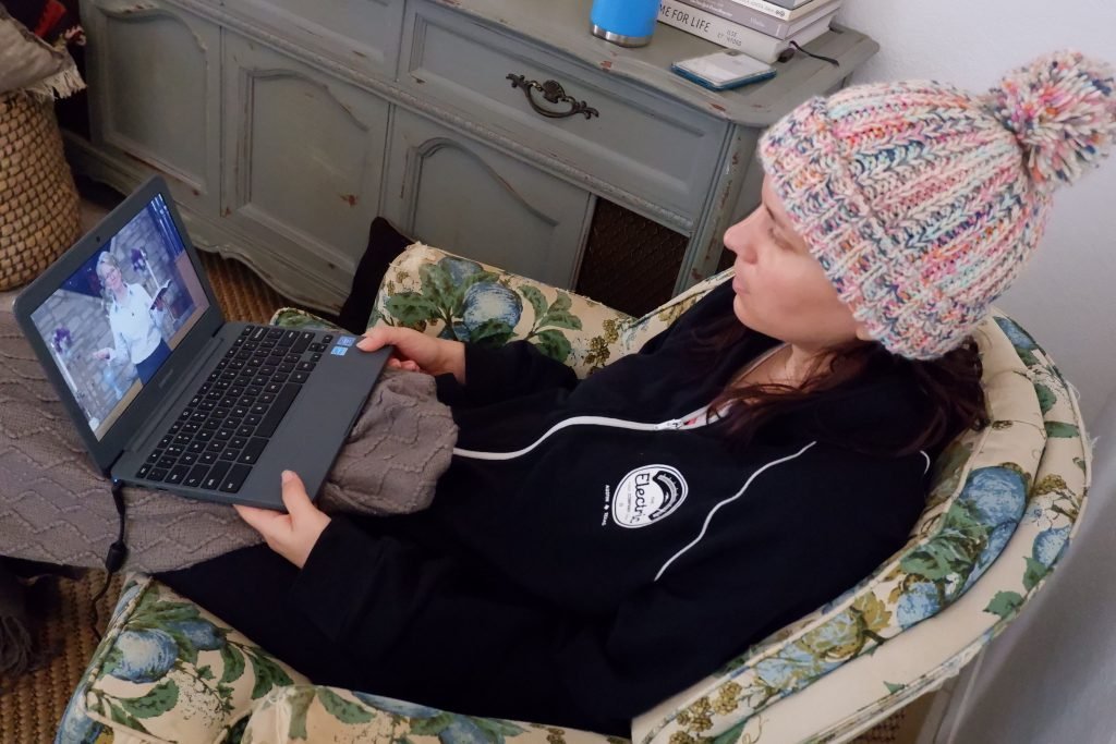 Nicolette Davis watches an online worship service on Nov. 26, 2020 from the comfort of her home in Austin, TX.