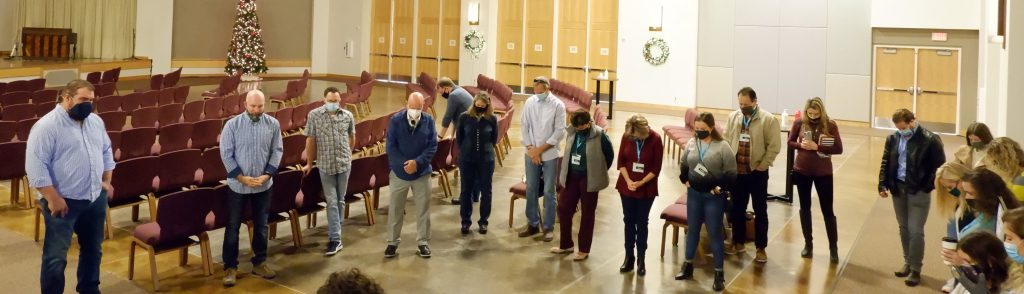 Pastor Chad McCartney leads volunteers and staff in prayer prior to a church service at Austin Oaks Church in Austin, TX, Dec. 6, 2020.