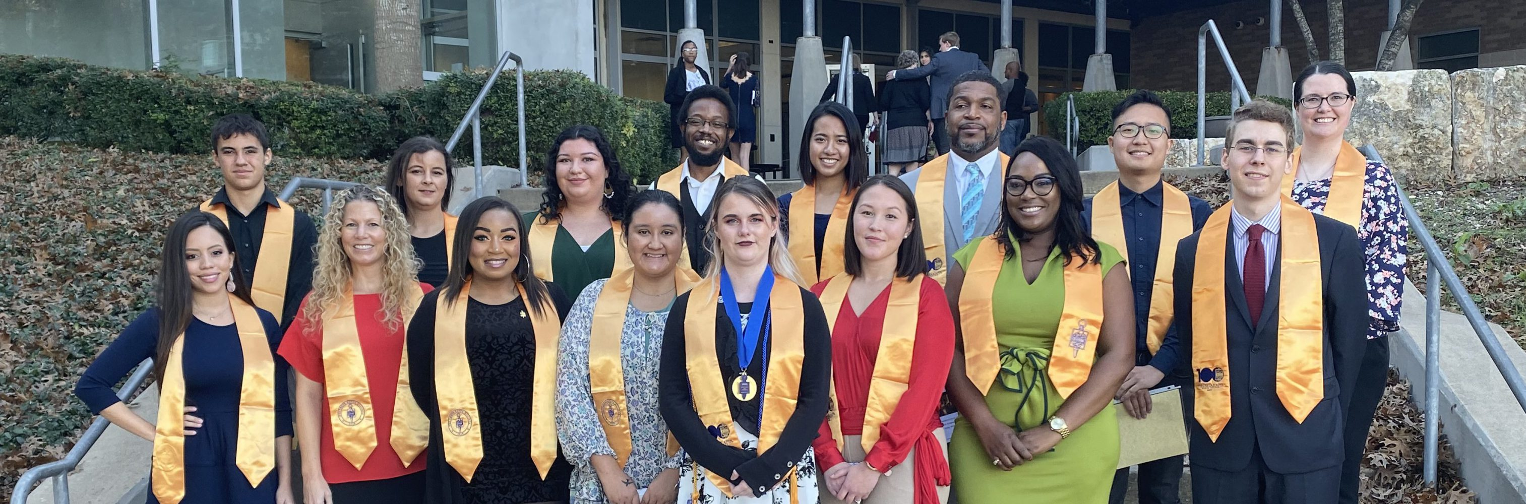 phi theta kappa gathers for a photo after an induction ceremony