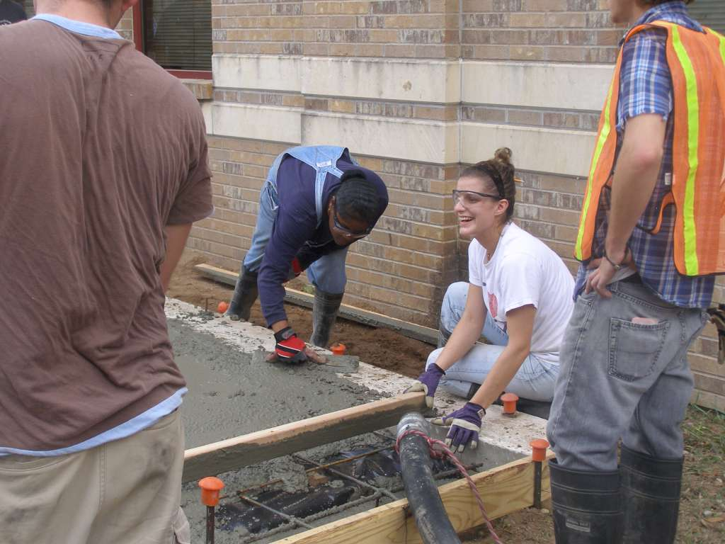 students screed and float concrete