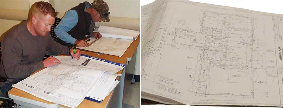 students reviewing blueprints