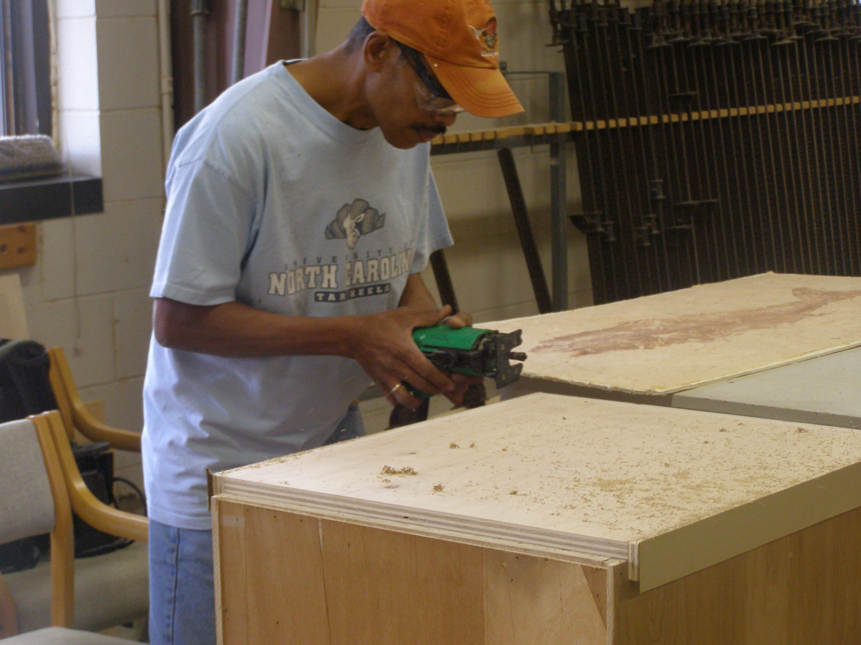student working on cabinet