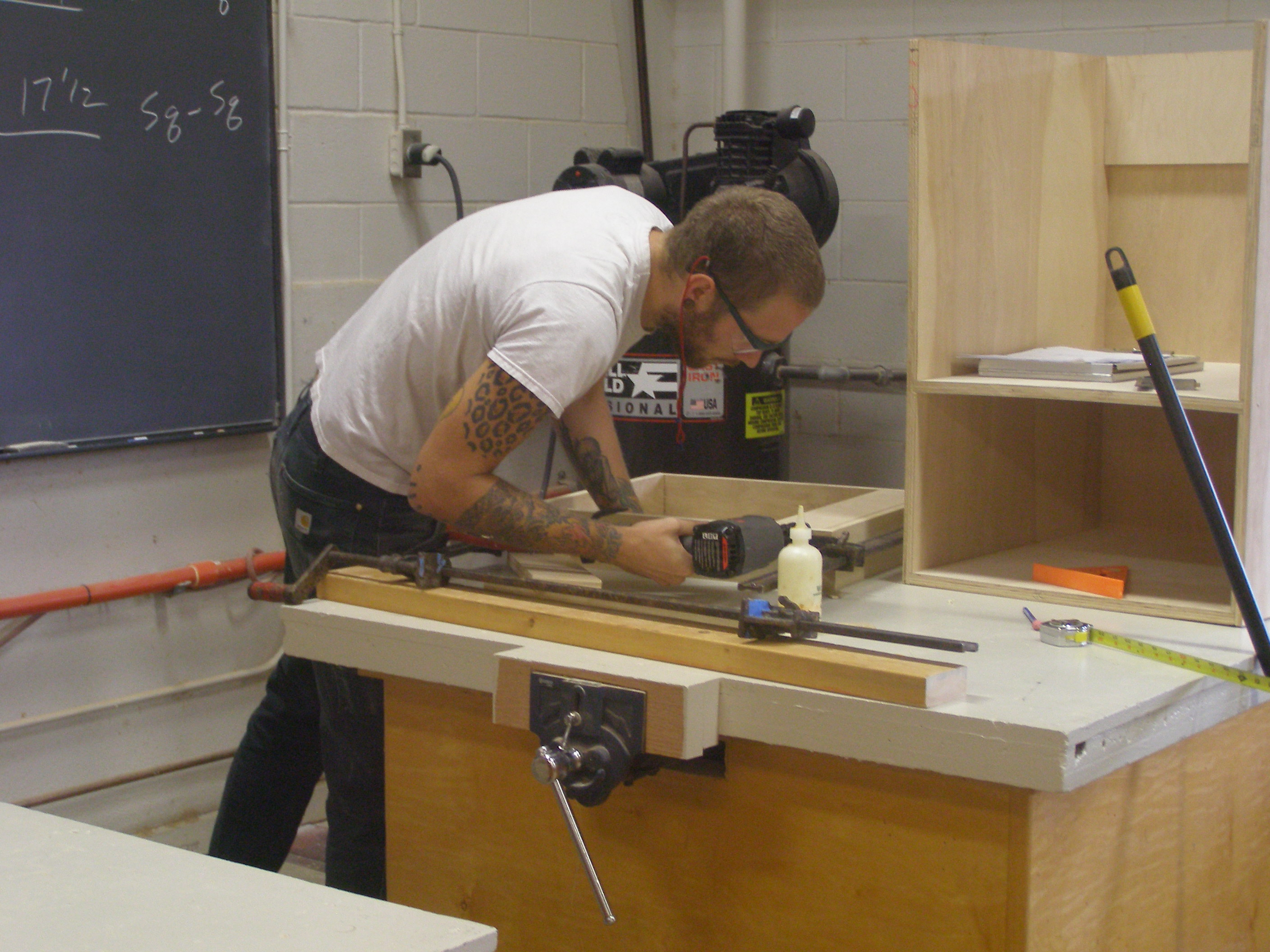 student building cabinet, nailing toeboard