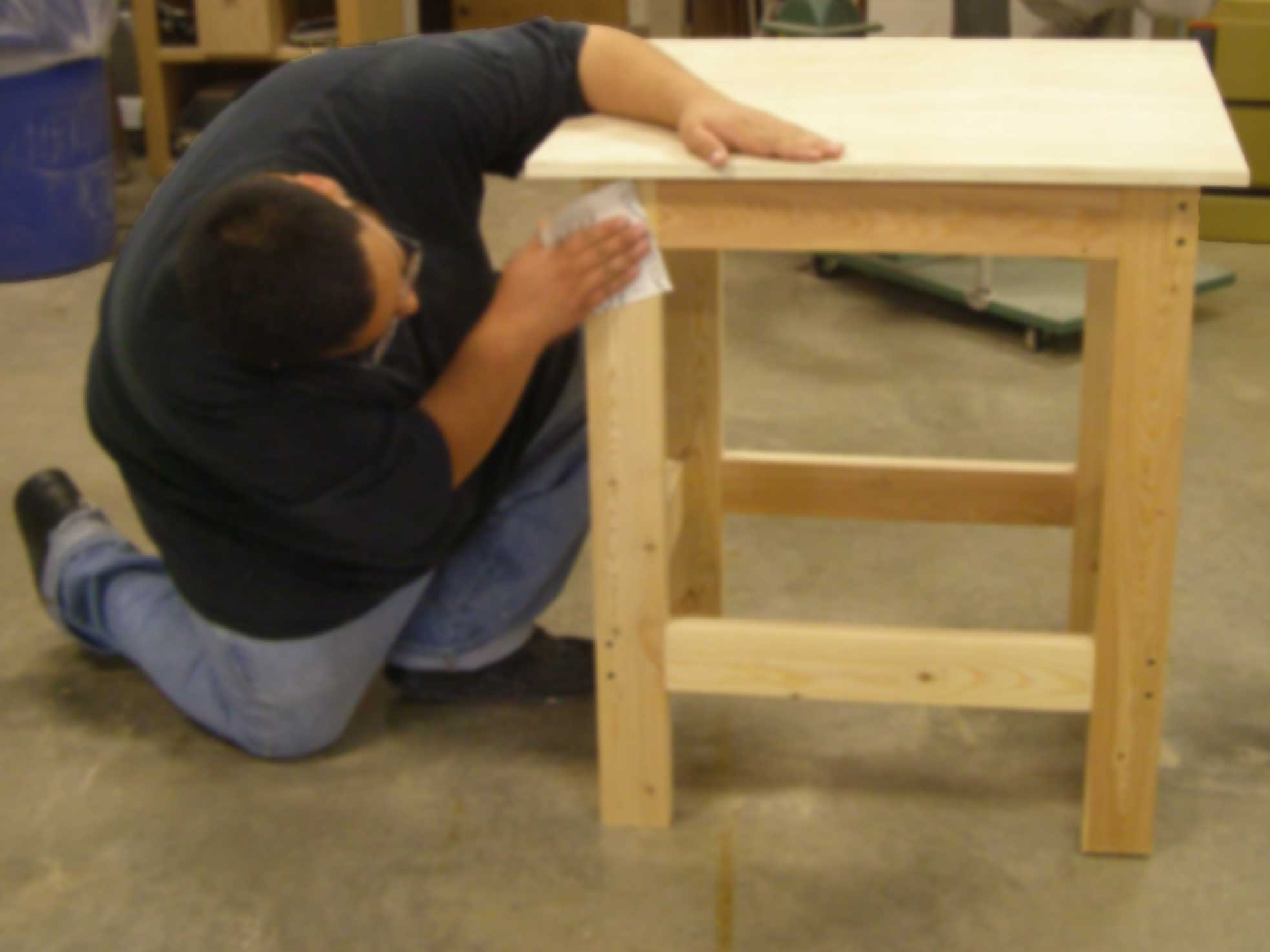 student sanding router table