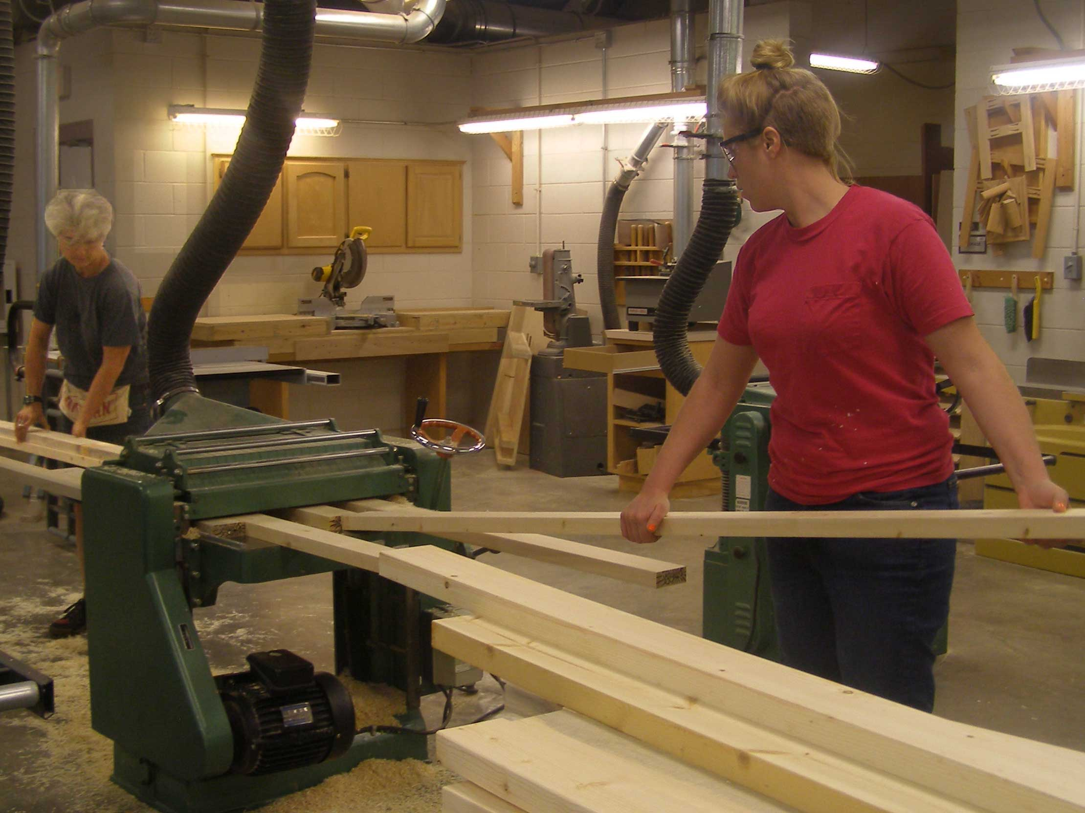 students planing table legs