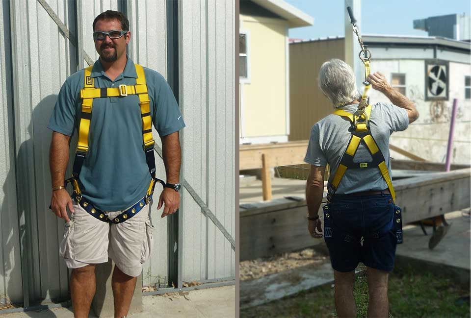 two instructors modeling the fall protection harness