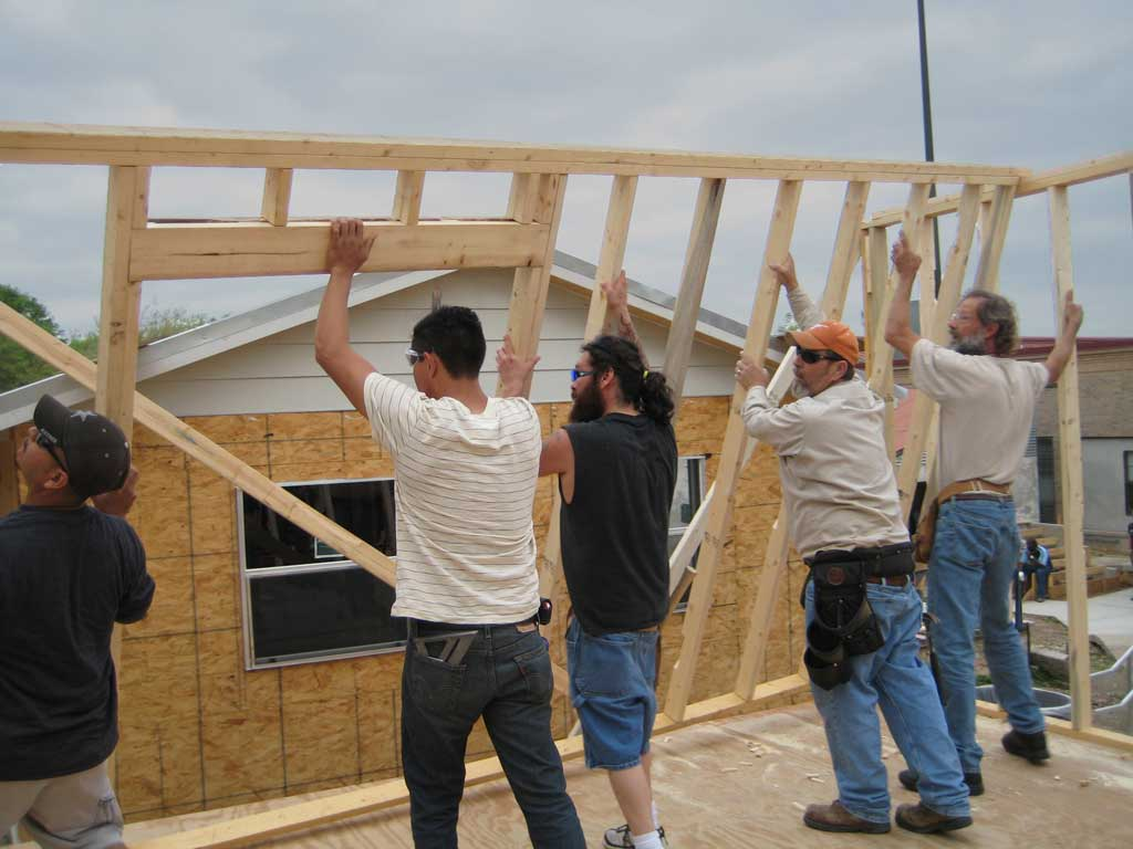 students raise a wall frame