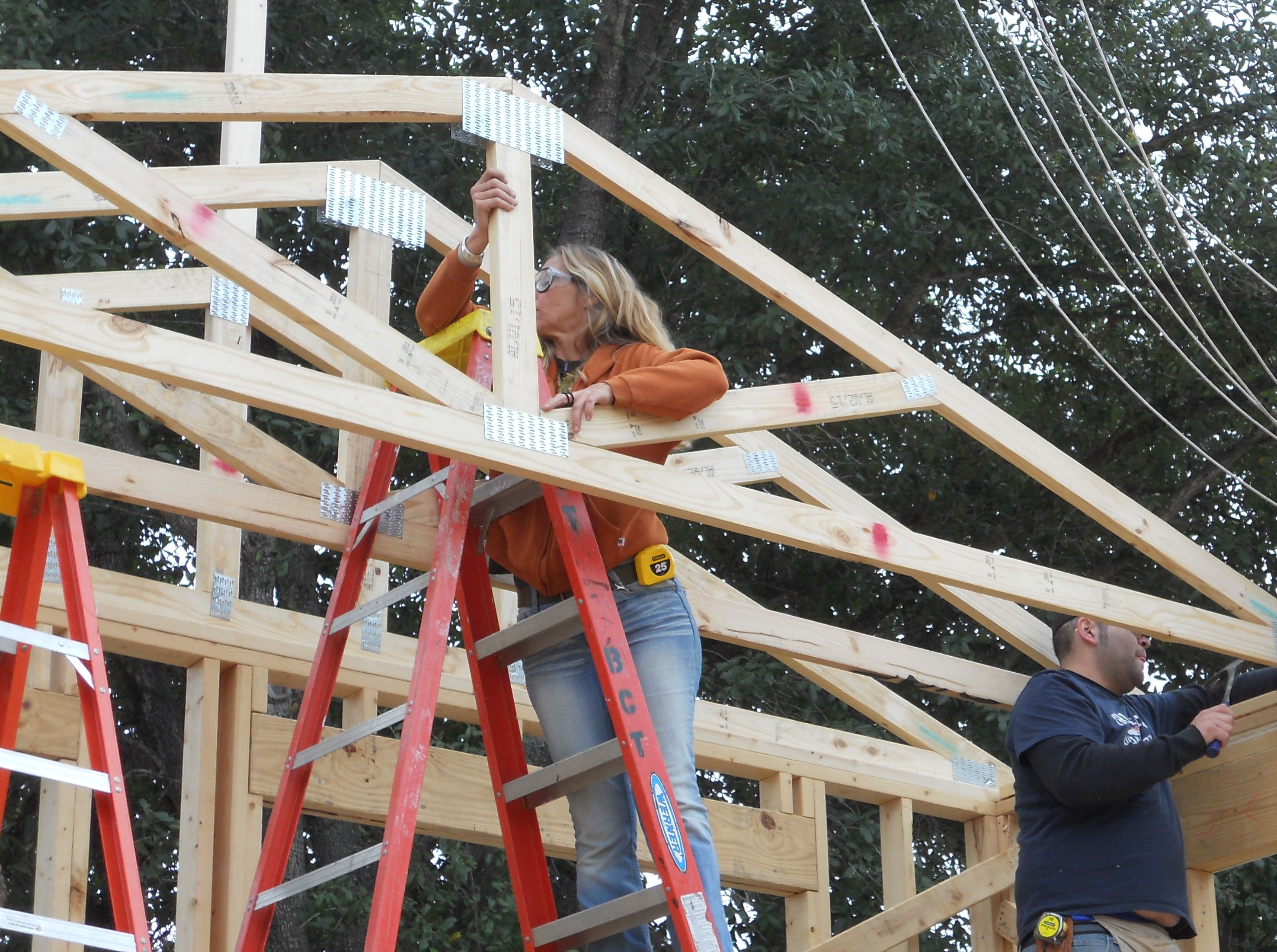students loading trusses