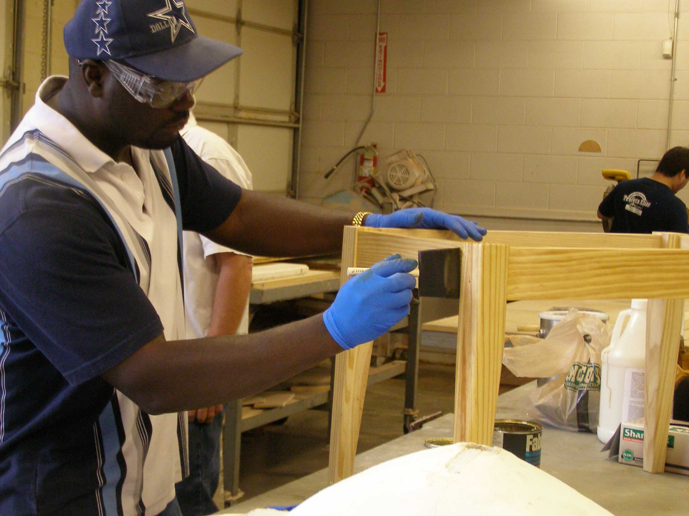 student staining wood table base