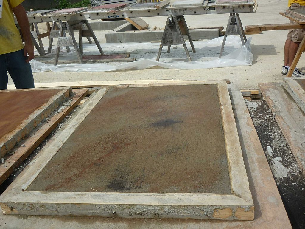 concrete tabletop curing in frame