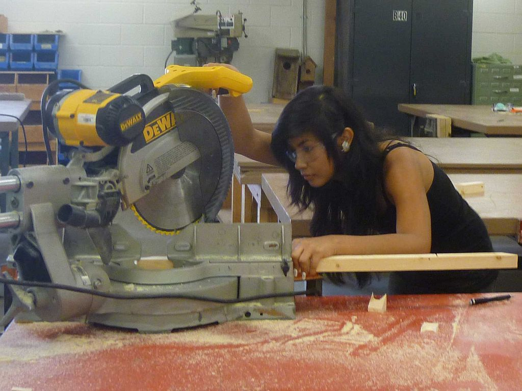 student using chopsaw