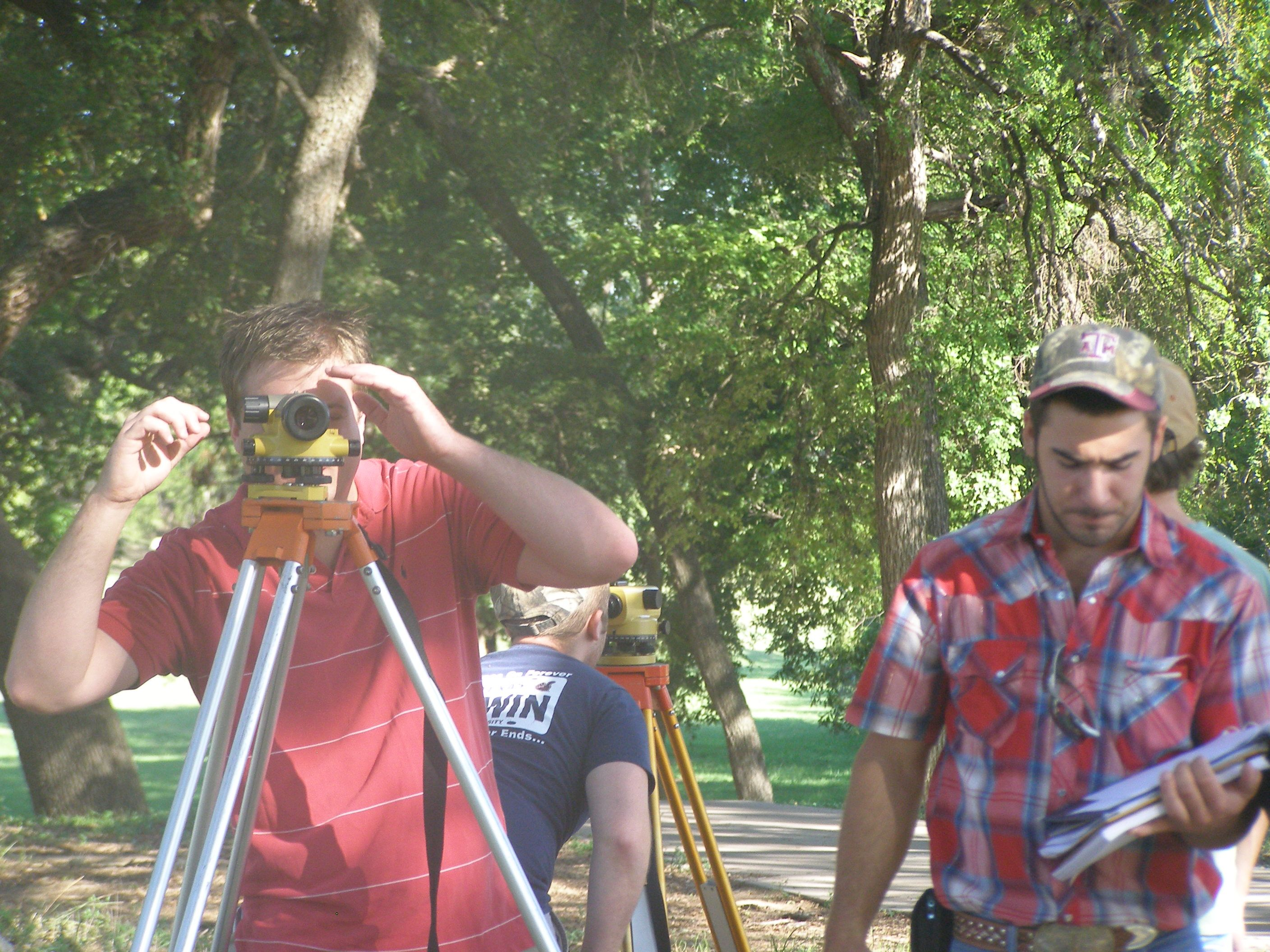 students surveying building layout