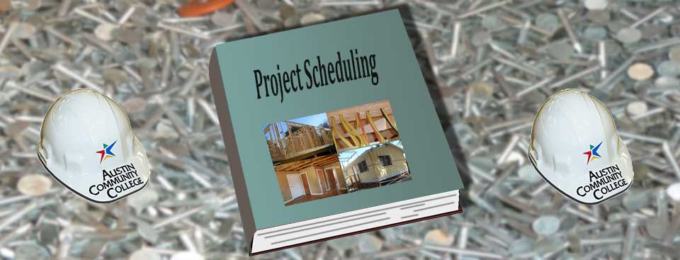 project scheduling book flanked by ACC hard hats