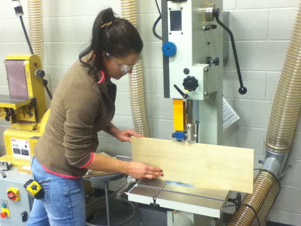 student using band saw