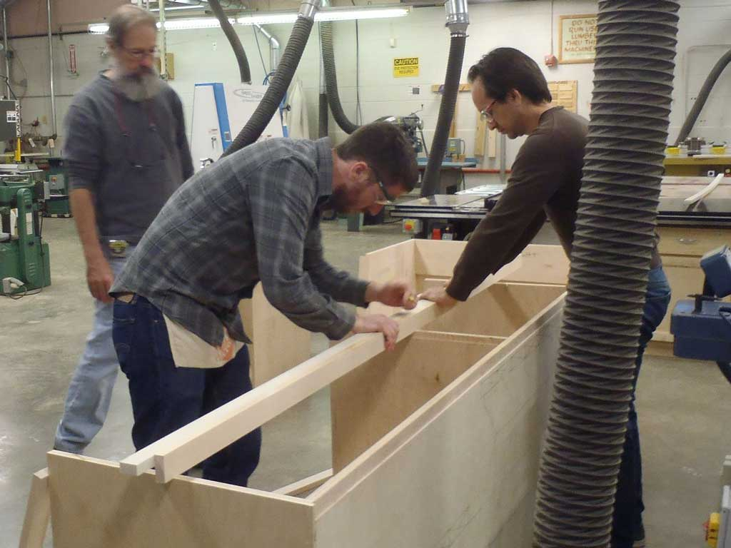 students working on base cabinets