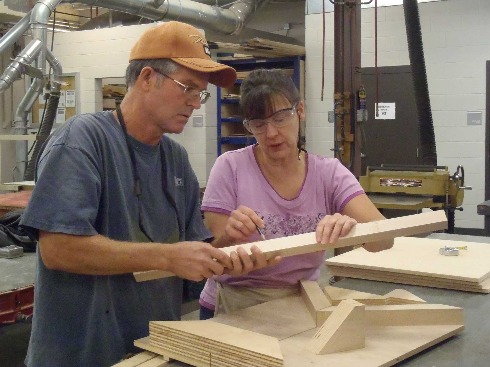 students measuring miter board