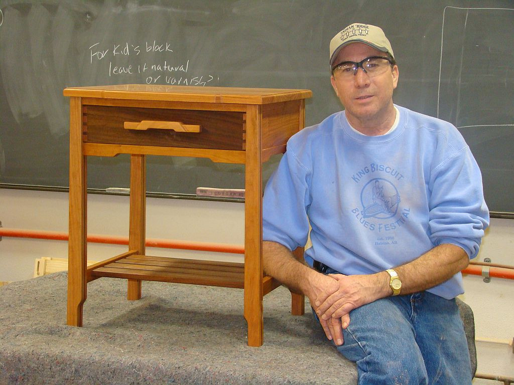student with finished nightstand