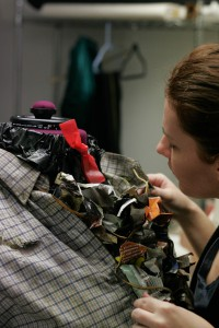 Lindsay Scarbrough working on the Scarecrow costume for The Wiz at Austin Community College Drama Department