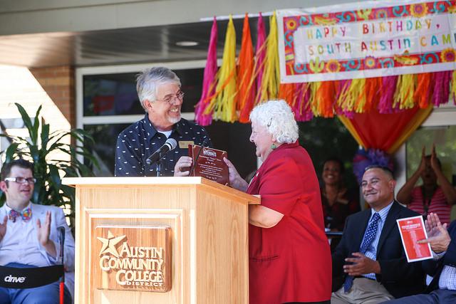 South Austin Campus Manager Tim Kelly thanks ACC Trustee Guadalupe Sosa for her support at the SAC 10th anniversary celebration August 4.
