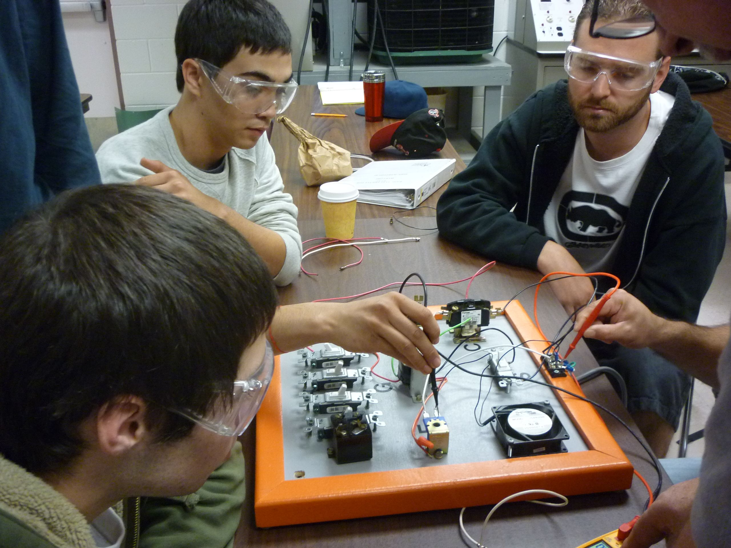 students measuring amps