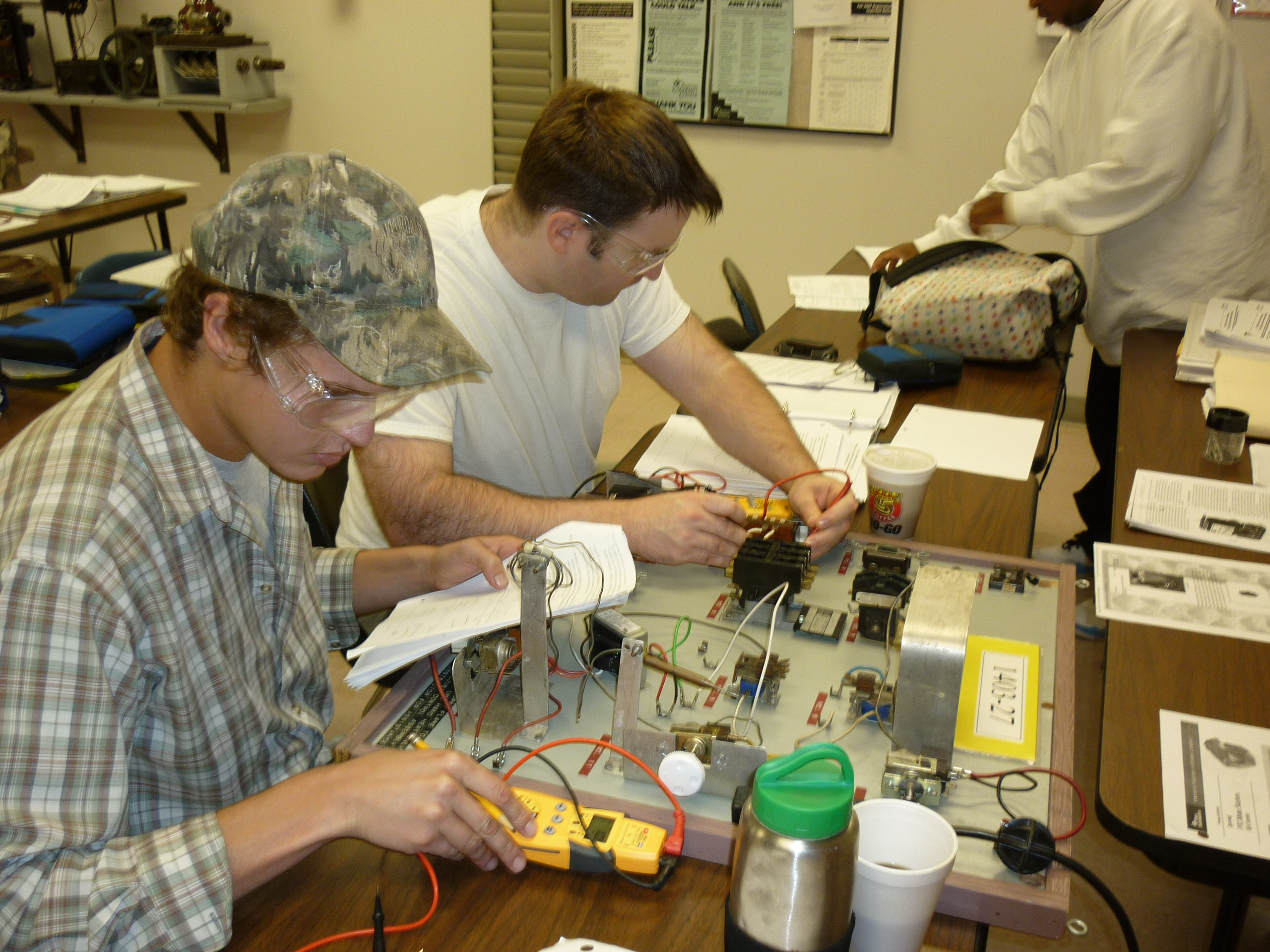 students working circuit board exercise