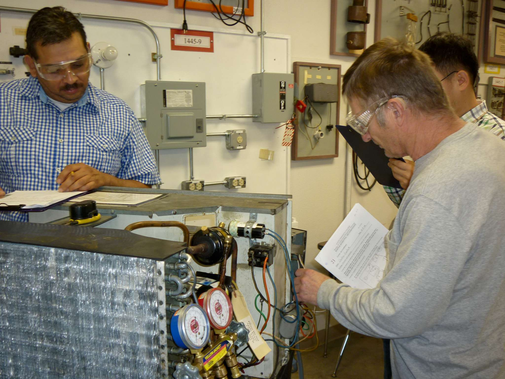 students diagnose and document room AC unit
