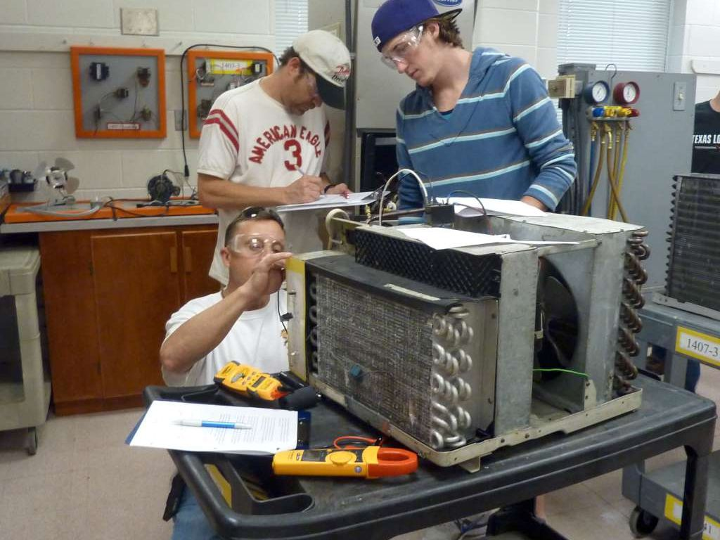 students checking fan motor voltage
