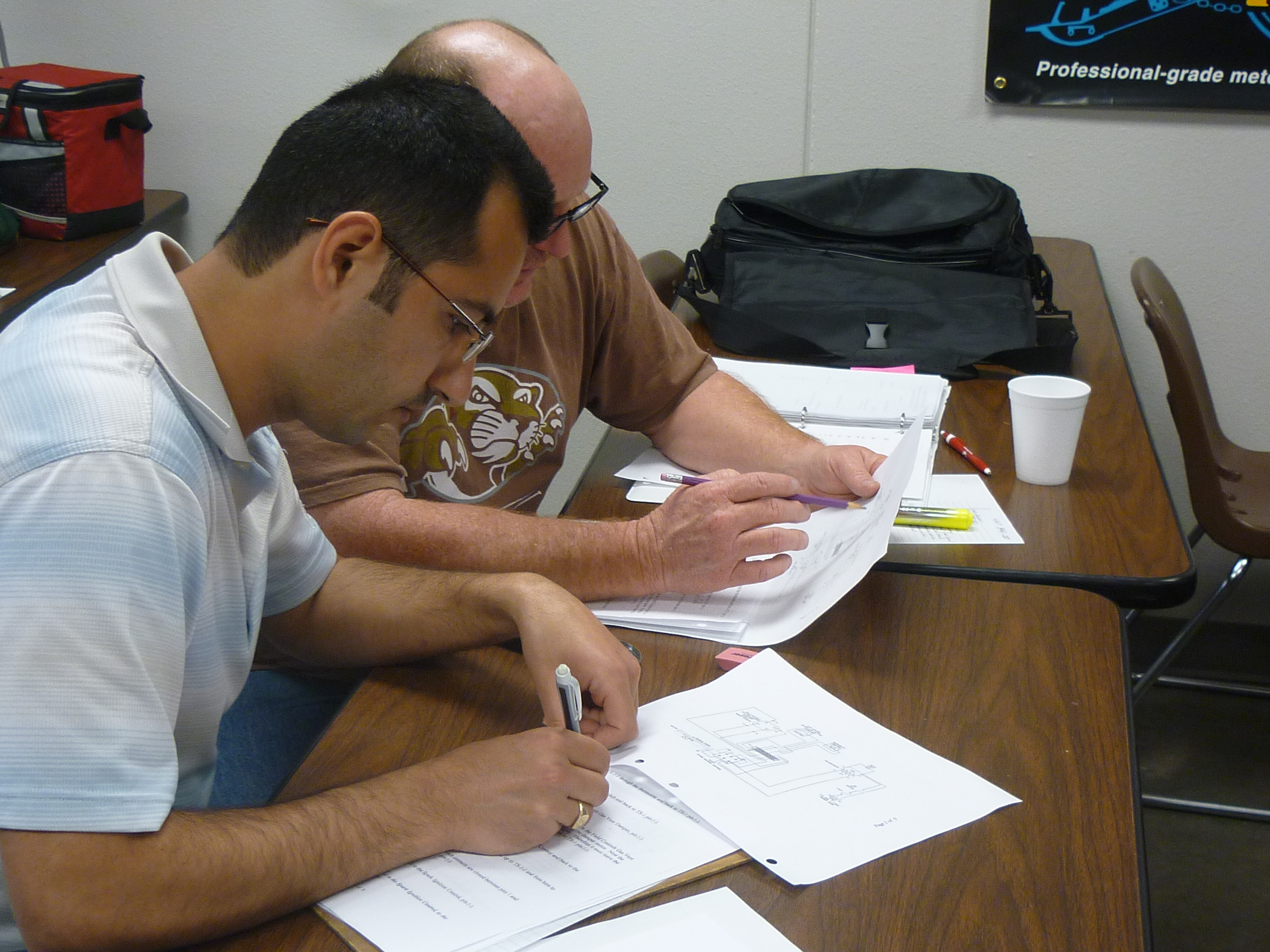2 students reviewing schematics