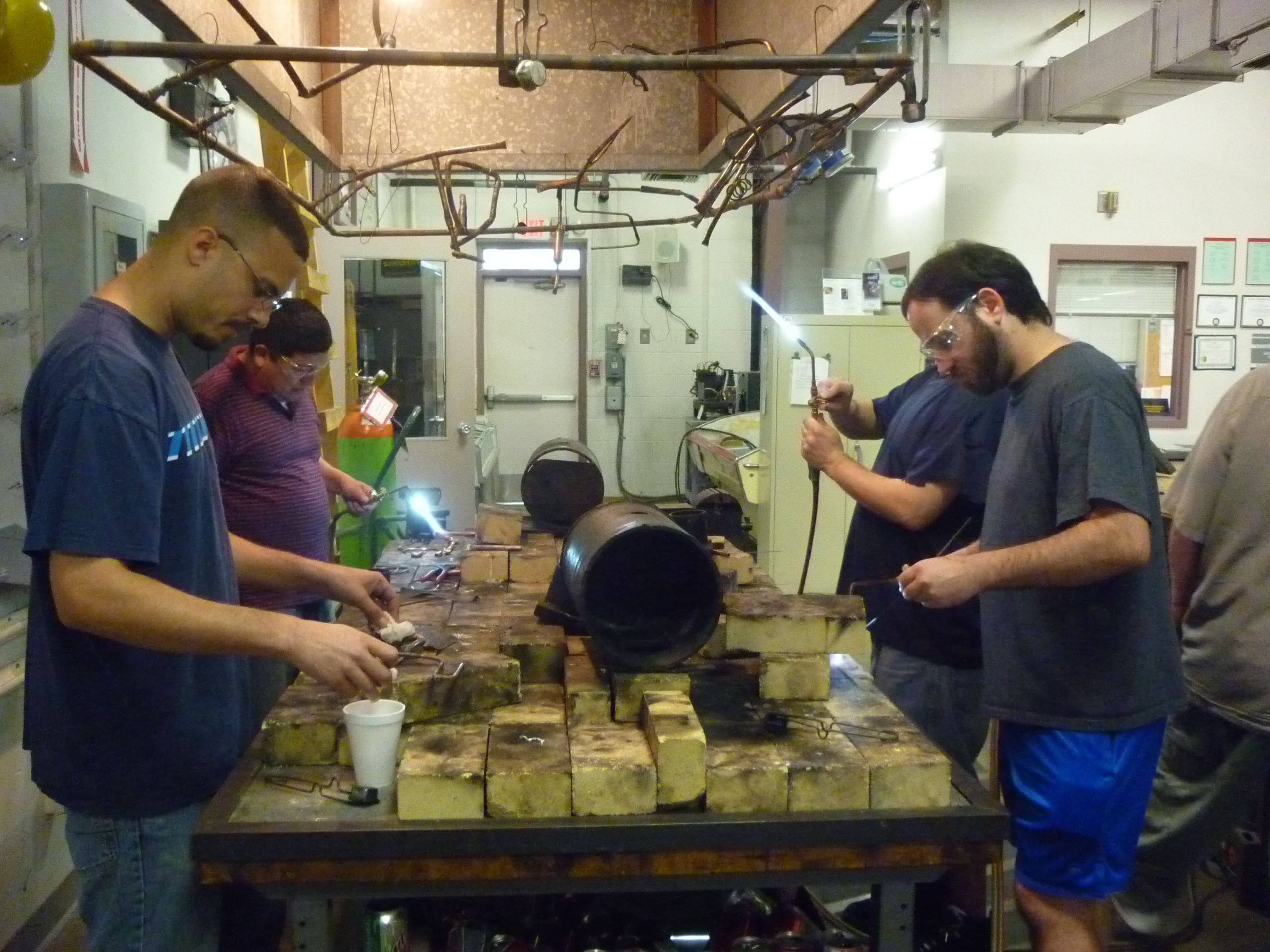 4 students brazing and adjusting flame