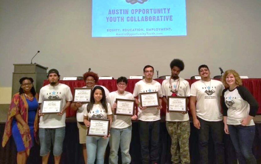 Dr. Stephanie Hawley presented certificates to AOYC Youth Ambassadors for their service to their community.
