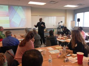Dr. Mark Gooden presents at an orientation session for the Equity Leadership Advisory Committee.